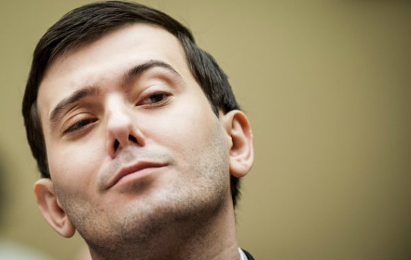 "Martin Shkreli, former chief executive officer of Turing Pharmaceuticals LLC, reacts during a House Committee on Oversight and Government Reform hearing on prescription drug prices in Washington, D.C., U.S., on Thursday, Feb. 4, 2016. Shkreli, who is no longer with Turing and faces federal fraud charges unrelated to the drugmaker, declined to make any comments to the committee. ""On the advice of counsel, I invoke my Fifth Amendment,"" Shkreli said. Photographer: Pete Marovich/Bloomberg via Getty Images"